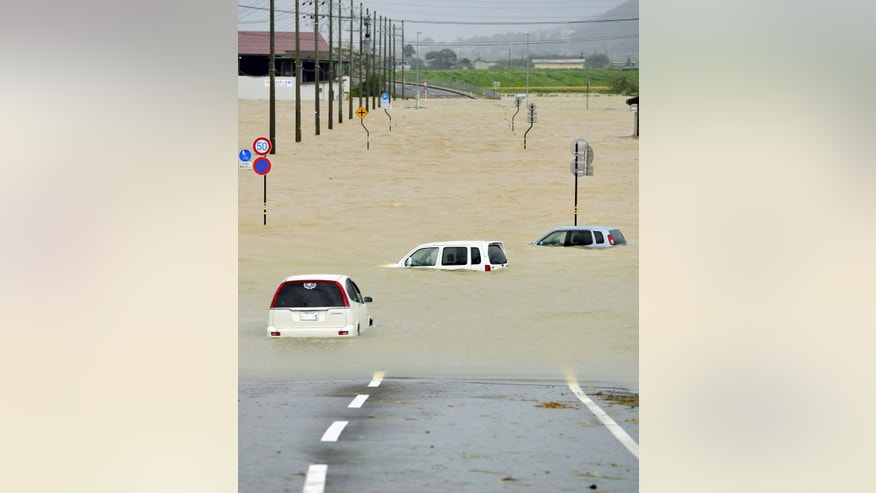 Sept. 16, 2013 - Cars submerged in water in area flooded by the torrential rains of a powerful typhoon in Obama, Fukui Prefecture, western Japan. Typhoon Man-yi, one of the most powerful storms to lash Japan this season,  went past Tokyo as people were ordered to evacuate to shelters.