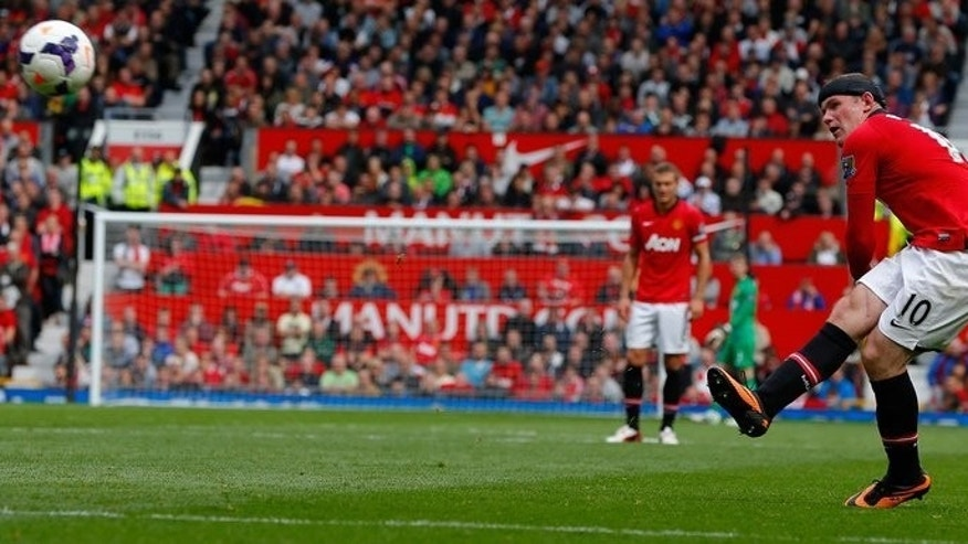 Manchester United striker Wayne Rooney scores during their Premier League match against Crystal Palace at Old Trafford in Manchester on September 14, 2013.