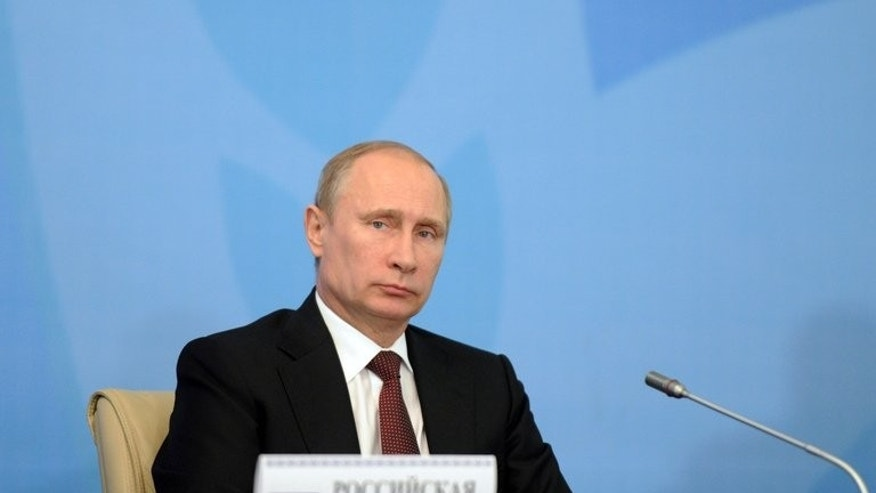 Russia's President Vladimir Putin takes part in a summit at the Ala-Archa state residence in Bishkek, on September 13, 2013.