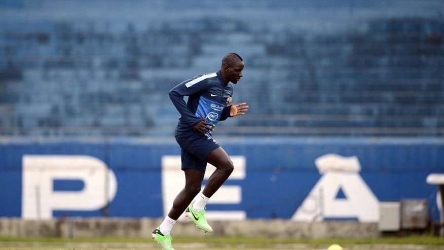 French international defender Mamadou Sakho runs during a training session at the Gremio Stadium in Porto Alegre, Brazil, on June 6, 2013. Sakho, who could make his Liverpool debut at Swansea City on Monday, hopes to repair a career that began to unravel on a wintry night in northwest France in January 2012.