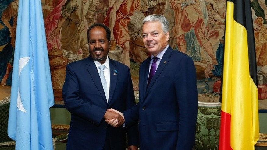 "Somali President Hassan Sheikh Mohamud (left) and Belgian Vice Prime Minister and Foreign Minister Didier Reynders shake hands before a bilateral meeting at the Egmont Palace in Brussels on September 16, 2013. International donors began work on a ""New Deal"" for Somalia to drive its economic and political recovery after two decades of bloody civil war."