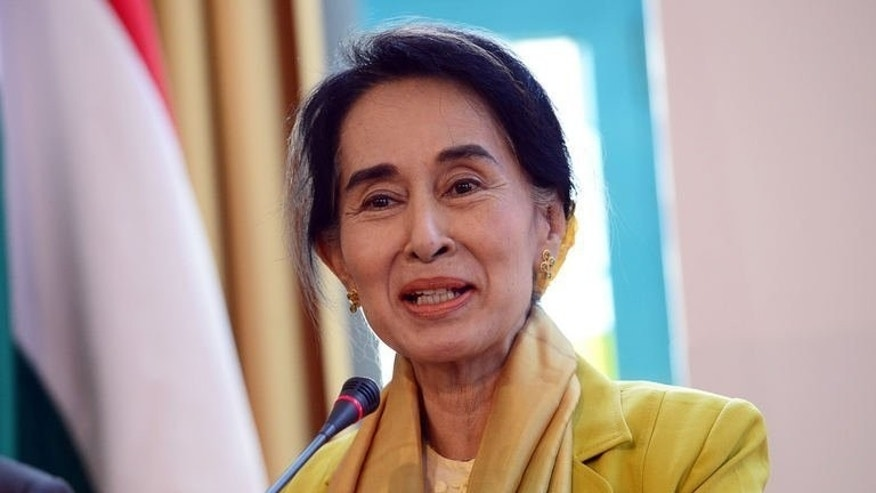 Myanmar's opposition leader Aung San Suu Kyi answers a question during a press conference in Budapest, on September 13, 2013. Suu Kyi has risked prompting Chinese anger after it was confirmed she had a private meeting with the Dalai Lama on the sidelines of a Prague rights conference.