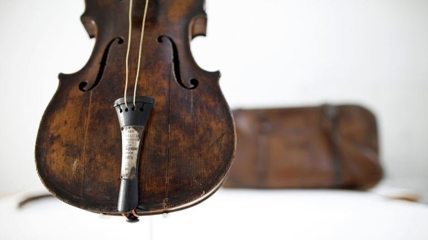 The violin played by bandmaster Wallace Hartley during the final moments before the sinking of the Titanic is displayed at a conservation studio in Lurgan, Northern Ireland, on September 16, 2013. The violin is to go on display at a museum marking the tragedy in Northern Ireland, officials said Monday.