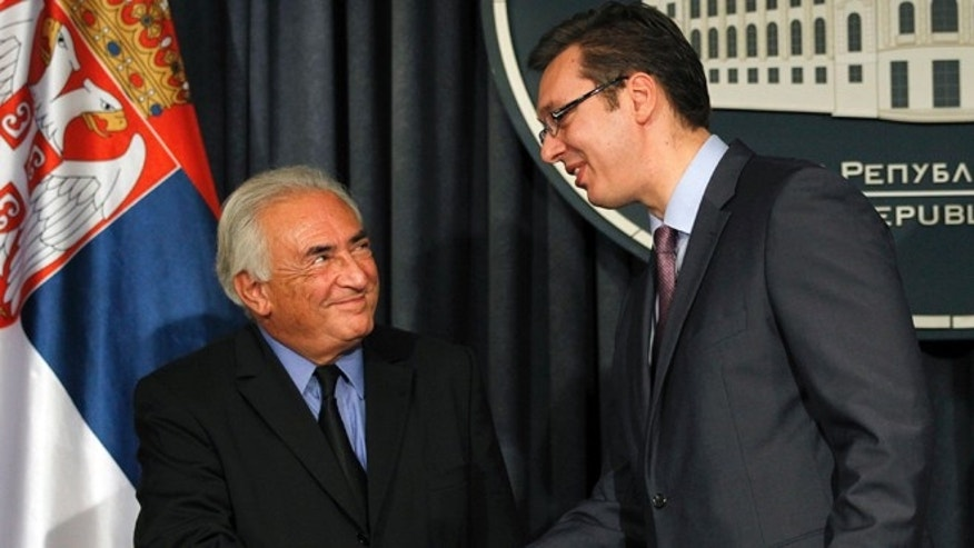 Sept. 17, 2013: Former International Monetary Fund chief Dominique Strauss-Kahn, left, shakes hands with Serbia's deputy Prime Minister Aleksandar Vucic after a press conference, in Belgrade, Serbia/