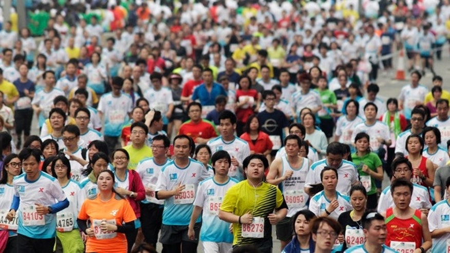 Feb. 24, 2013: Participants run on the Eastern Corridor expressway during a 10-kilometer race as part of the Hong Kong Marathon.