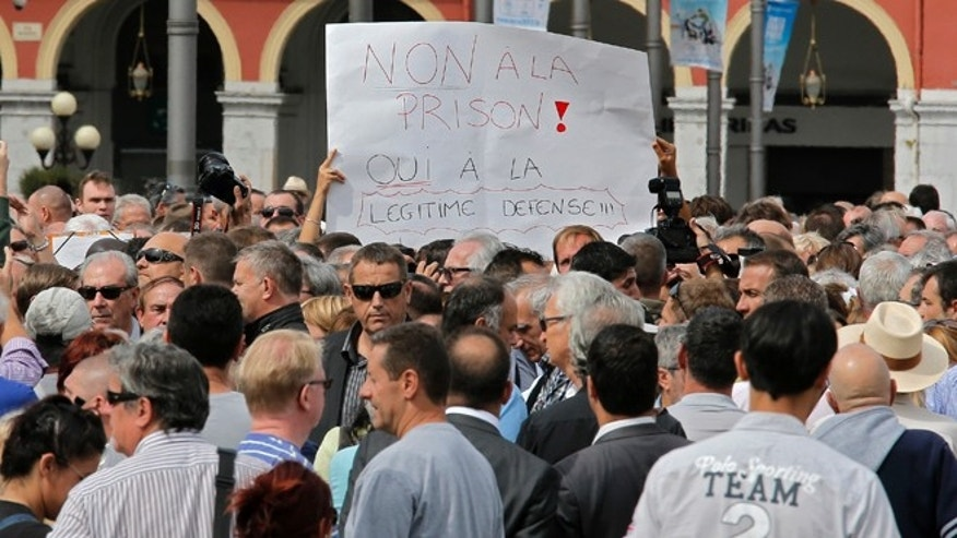 "Sept. 16, 2013: Nice citizens, holden a banner writing ""No in jail, Yes to self defense"", take part in a rally supporting Stephan Turk in Nice southeastern France."