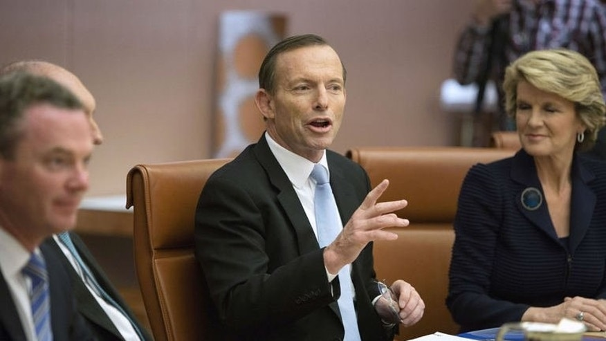 New Australian Prime Minister Tony Abbott (C) chairs the first meeting of the full ministry at Parliament House in Canberra on September 18, 2013.