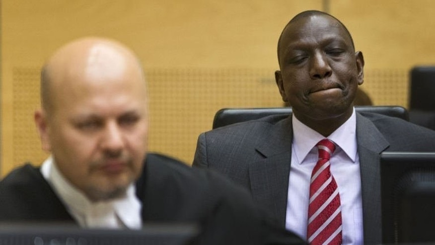 Kenya's Vice President William Ruto (R) sits in the courtroom before the start of his trial at the International Criminal Court (ICC) in The Hague on September 10, 2013.