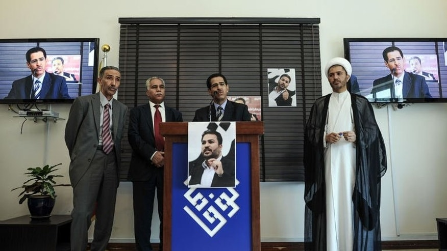 Bahrain's Al-Wefaq opposition group leader Sheikh Ali Salman (R), Bahraini opposition representative Abdulnabi Salman (C), and Bahraini opposition representative, Radhi Al-Mosawi (C-L) attend a press conference in the village of Zinj, west of Manama, on September 18, 2013.