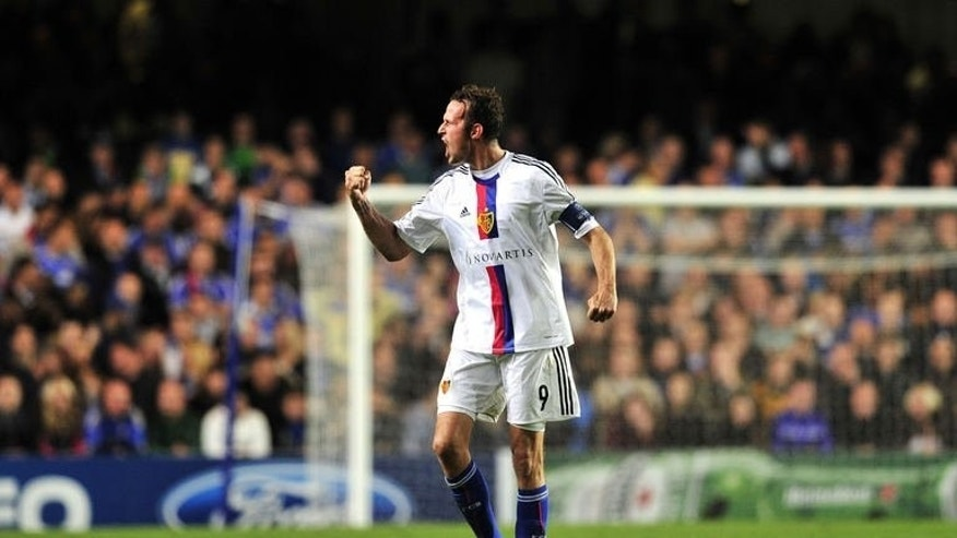 FC Basel's Swiss striker Marco Streller celebrates scoring his team's second goal against Chelsea during their UEFA Champions League Group E football match at Stamford Bridge in London on September 18, 2013. Basel won 2-1.