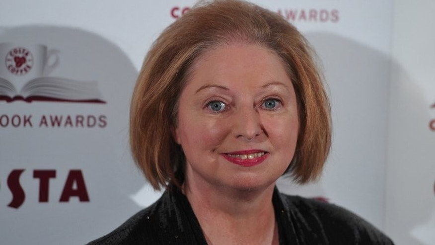 "Author Hilary Mantel, writer of 'Bring Up The Bodies' poses for photographers in London on January 29, 2013. The Man Booker Prize announced that it was expanding to cover all novels written in the English language, saying it would welcome authors whether they come from ""Chicago, Sheffield or Shanghai""."