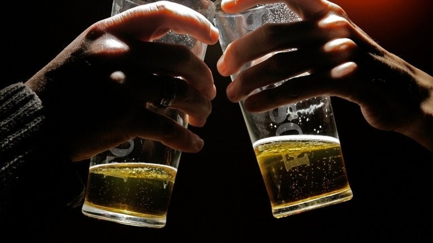 People drink beer at a London pub on November 23, 2005. Inebriated individuals causing nuisance should be lodged in privately-run drunk tanks and made to pay for their care, police chiefs said on Wednesday.