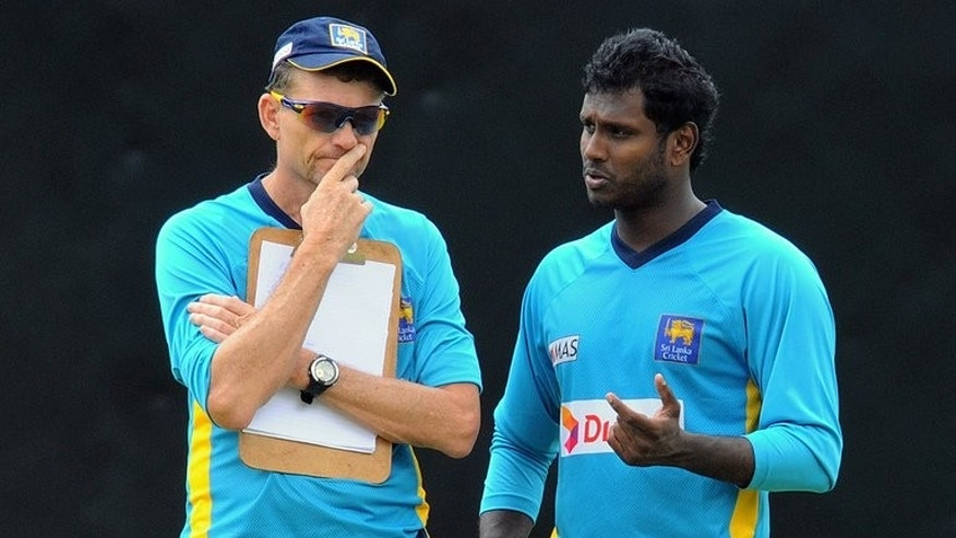 Sri Lankan captain Angelo Mathews (right) speaks with Graham Ford in Pallekele in July. Sri Lanka will seek a new coach after South African Graham Ford declined to extend his two-year term beyond January, cricket officials said on Wednesday.