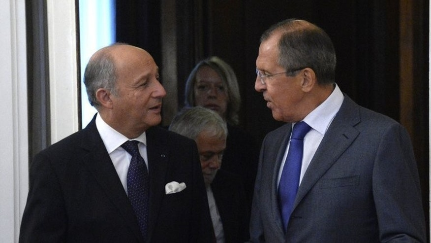 Russia's Foreign Minister Sergei Lavrov (right) speaks with his French counterpart Laurent Fabius during their meeting in Moscow, on September 17, 2013.