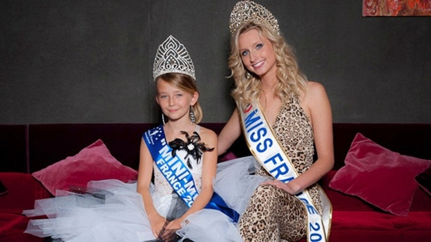 This undated photo provided by the Mini Miss committee shows Oceane Scharre, 10, elected Mini Miss France 2011, left, and Miss France 2011 Mathilde Florin. France&#39&#x3b;s Senate voted Tuesday night, Sept. 17, 2013, to ban beauty pageants for children under 16, in an effort to protect children especially girls from being sexualized too early.