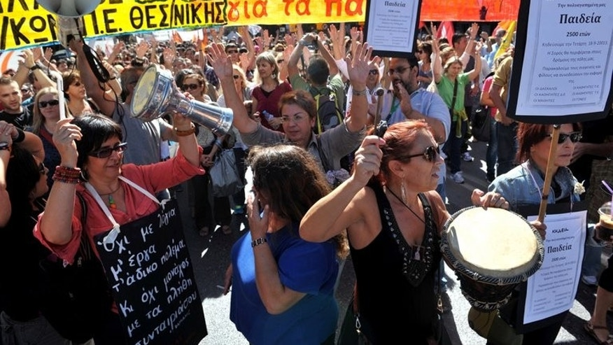 Teachers shout slogans in Thessaloniki on Wednesday during a 48-hour civil servants strike. The protests were held in a tense climate following the killing hours earlier of a left-wing artist allegedly by a suspected member of neo-Nazi party Golden Dawn.