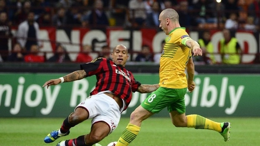 AC Milan's Nigel de Jong (L) and Celtic Glasgow's Scott Brown during their Champions League match at the San Siro Stadium in Milan on September 18, 2013.