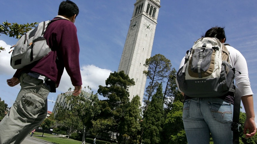 BERKELEY, CA - APRIL 17:  UC Berkeley students walk by Sather Tower on the UC Berkeley campus April 17, 2007 in Berkeley, California.  Robert Dynes, President of the University of California, said the University of California campuses across the state will reevaluate security and safety policies in the wake of the shooting massacre at Virginia Tech that left 33 people dead, including the gunman, 23 year-old student Cho Seung-Hui.  (Photo by Justin Sullivan/Getty Images)