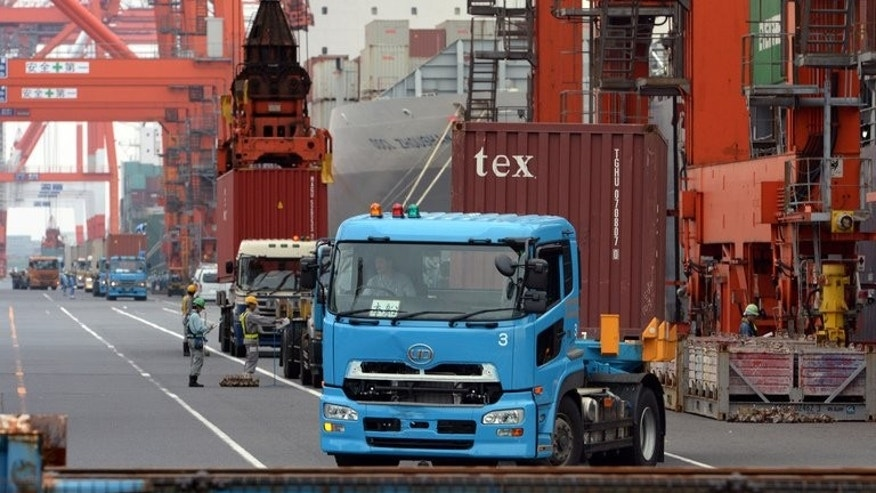 Shipping containers are unloaded in Tokyo. Japan's trade deficit ballooned by a quarter to $9.8 billion in August, official data showed September 19, 2013.