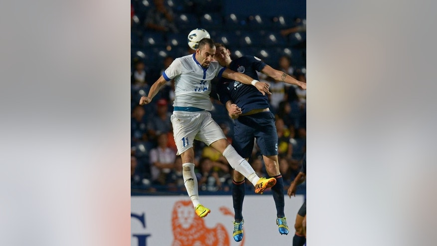 Osmar Barba (right) clashes with Mohammad Ghazi Najafabadi of Iran's Esteghlal in Buriram on Wednesday. Buriram sent their fans into a frenzy at a packed Thunder Castle Stadium when Spanish defender Barba scored in the first half against Esteghlal, levelling the tie at 1-1 after last month's 1-0 loss.
