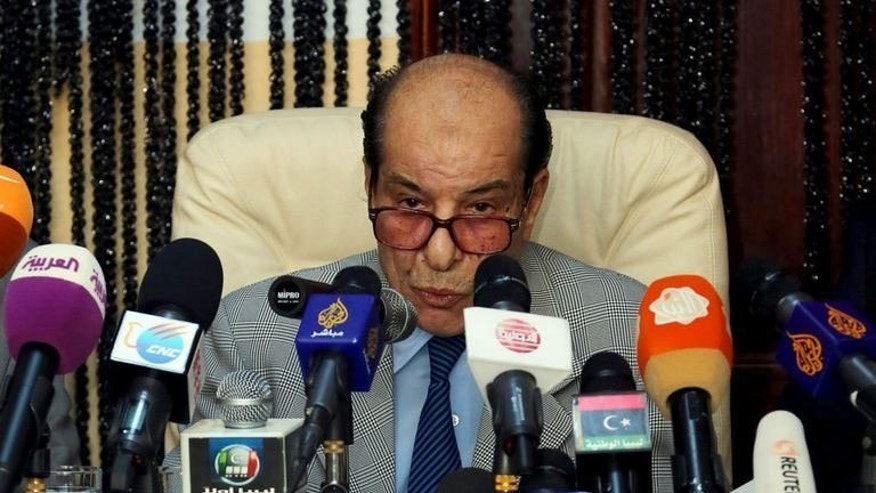 Libya General Prosecutor Abdulqader Radwan gives a press conference on the eve of the trial of Seif al-Islam on September 18, 2013 in Tripoli.