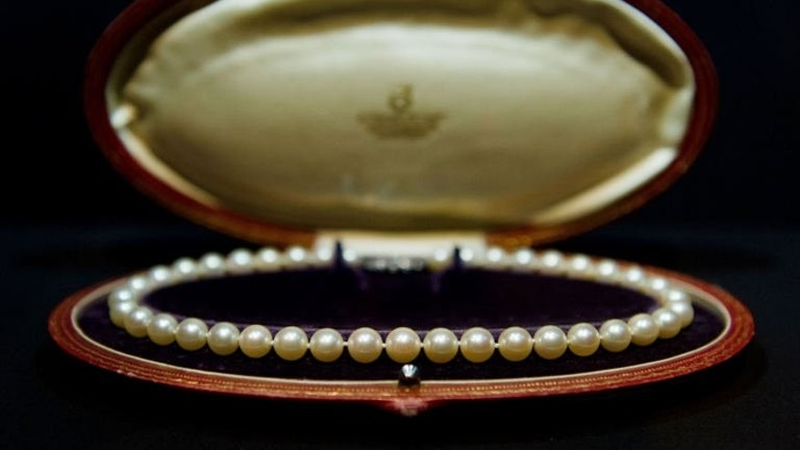 "An Akoya pearl necklace, previously owned by Marilyn Monroe, is displayed in the V&A's ""Pearls"" exhibition in west London on September 18, 2013."