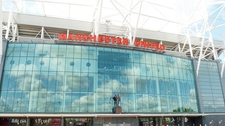 Tourists outside Manchester United's Old Trafford ground on October 4, 2004.