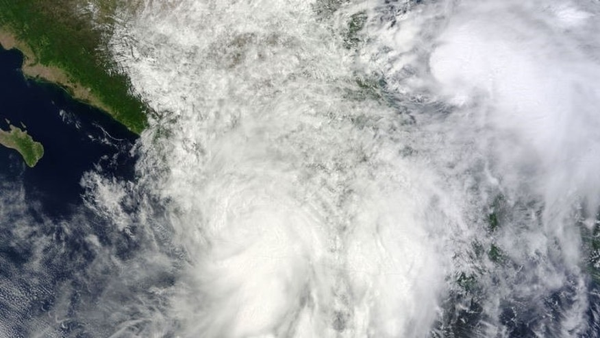 This image from NASA's Terra satellite obtained September 18, 2013 shows two storms over Mexico on the morning of September 15, 2013.