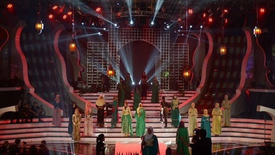 Contestants of the Muslimah World pageant take part in a rehearsal for the grand final of the contest in Jakarta on September 18, 2013. The finale of a beauty pageant exclusively for Muslim women will take place in the Indonesian capital Wednesday, in a riposte to the Miss World contest in Bali that has drawn fierce opposition from Islamic radicals.