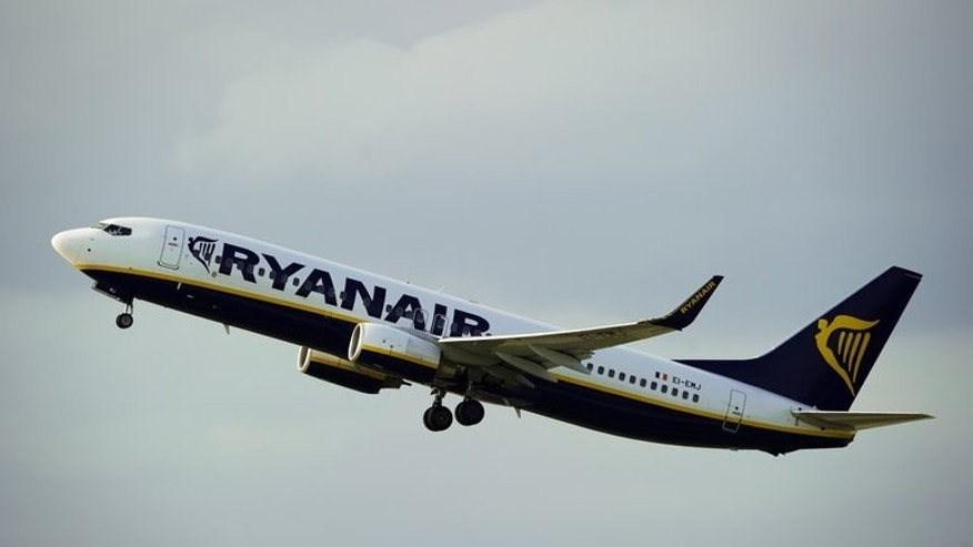 A Ryanair Boeing 737 takes off from Barcelona's airport on September 01, 2010. A group of drunk, dancing Scottish passengers caused such a commotion on a Ryanair flight from Glasgow to Ibiza that they forced the plane to make an emergency landing near Paris.