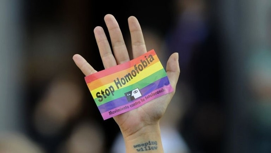 A demonstrator at a rally in Madrid on September 3 against repression of gays in Russia. The English Premier League said on Wednesday that it is happy for players to wear rainbow-coloured laces this weekend as part of a campaign against homophobia in football.