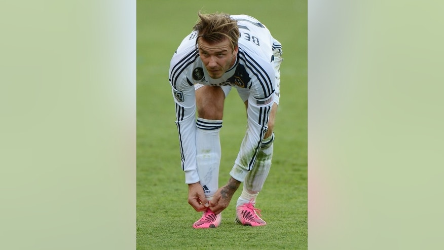David Beckham ties a shoelace in his final game for Los Angeles Galaxy in Carson, California last December. Gay rights charity Stonewall has sent striped laces to all 134 professional clubs in England and Scotland.