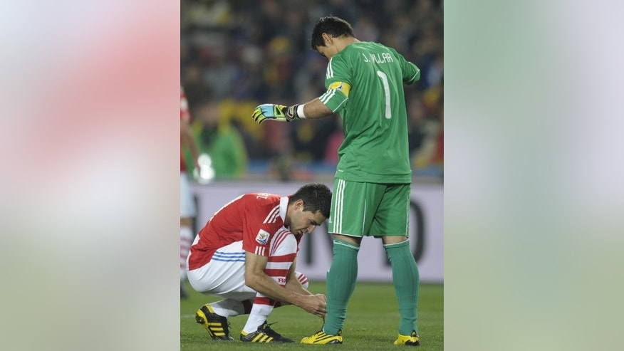 Antolin Alcaraz (left) ties a lace for Paraguay teammate Justo Villar in Johannesburg during the 2010 World Cup. Although the Premier League was not consulted about the Right Behind Gay Footballers campaign, it said it supported the initiative.