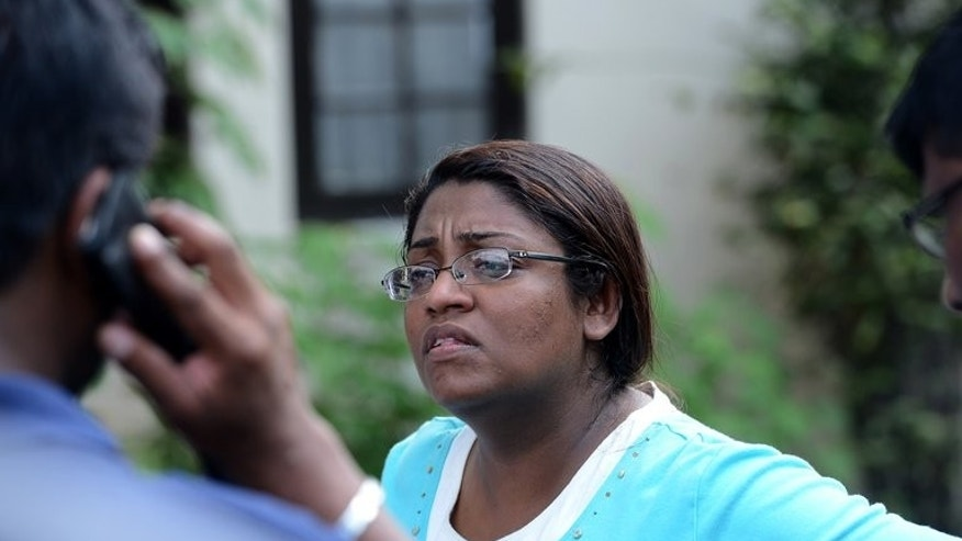 In this photograph taken on August 24, 2013, Sri Lankan editor Mandana Ismail Abeywickrema speaks with colleagues in Colombo. Abeywickrema has fled the country following death threats and an armed attack on her home in Colombo, according to a media rights group.