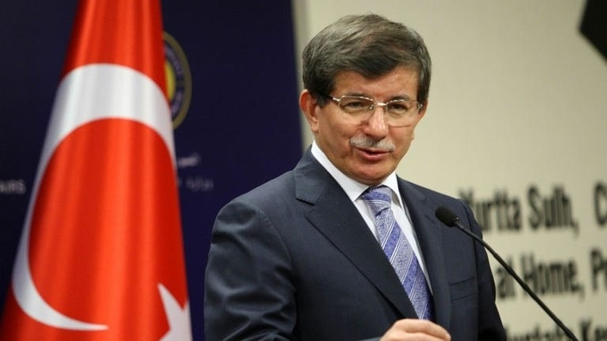 Turkish Foreign Minister Ahmet Davutoglu speaks to the media during a news conference in Ankara, September 18, 2013.