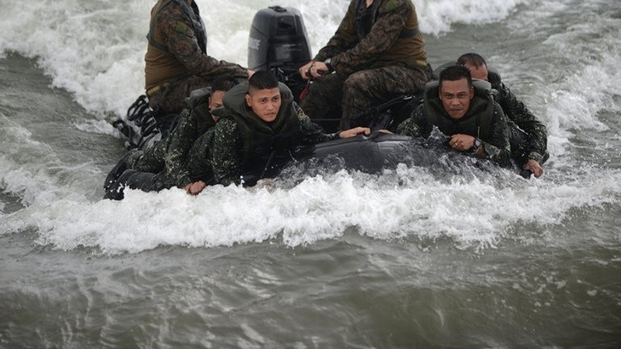 US and Philippine marines participate in small boat operations training at the seaNavy Education Training Center (NETC) in San Antonio, Zambales province, northwest of Manila on September 18, 2013. The Philippines and the United States launched war games at a naval base facing turbulent waters claimed by China, as the allies sought to highlight their expanding military alliance.