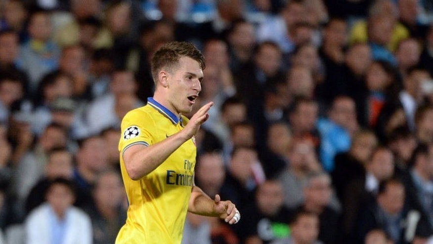 Arsenal's Welsh midfielder Aaron Ramsey celebrates after scoring a goal on September 18, 2013 at the Velodrome stadium in Marseille, southern France, during the UEFA Champions League group F football match Marseille vs. Arsenal. Arsenal won 2-1.