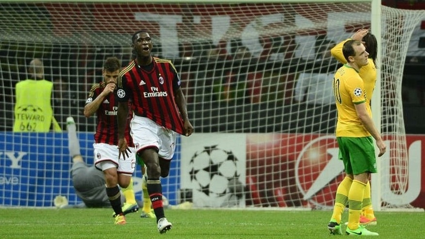 AC Milan's Colombian defender Cristian Zapata celebrates after scoring during the Champions League football match between AC Milan and Celtic Glasgow, on September 18, 2013 in San Siro Stadium in Milan. Milan won 2-0.