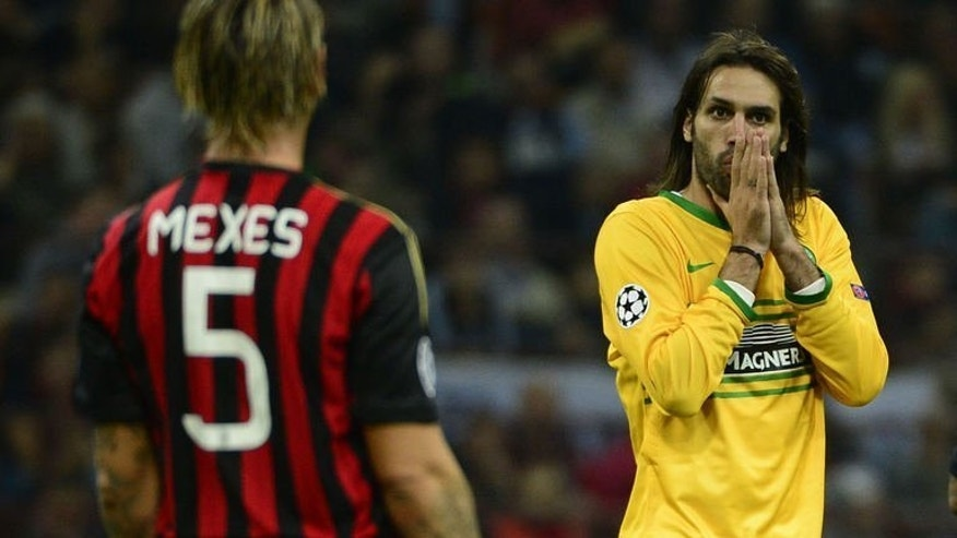 Celtic Glasgow's Greek forward Giogios Samaras reacts during the Champions League football match between AC Milan and Celtic Glasgow, on September 18, 2013 in San Siro Stadium in Milan. Milan won 2-0.