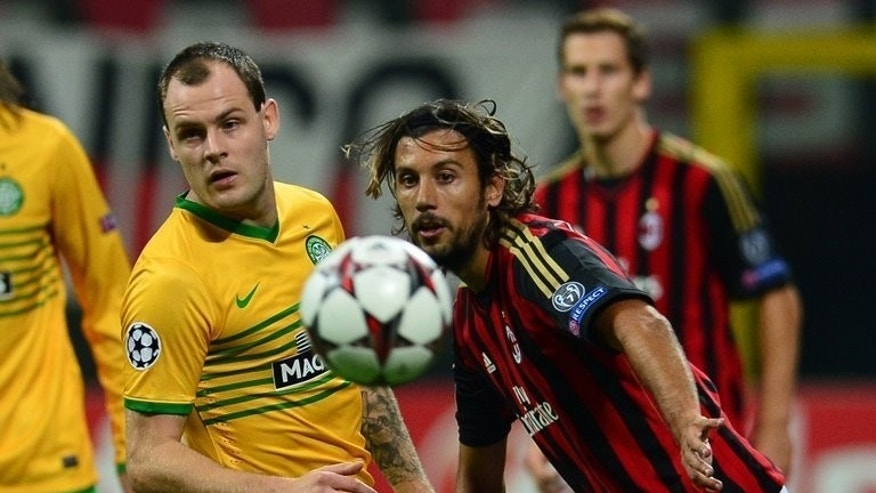 Celtic's forward of Ireland Anthony Stokes (L) fights for the ball with AC Milan's defender Cristian Zaccardo during their Champions League football match between AC Milan and Celtic on September 18, 2013 at San Siro Stadium in Milan. Milan won 2-0.