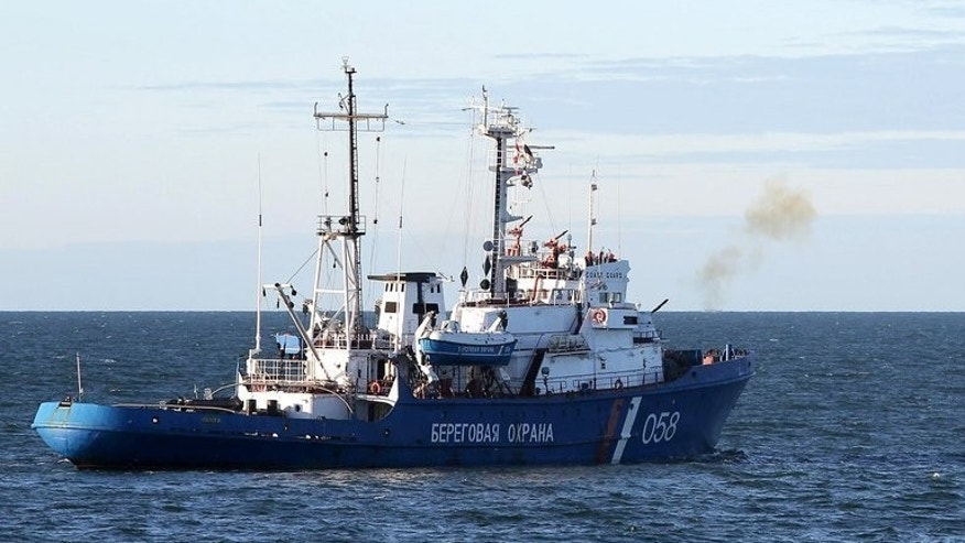 A Russian Coast Guard ship fires a warning shot to stop the Arctic Sunrise Greenpeace icebreaker in the Pechora Sea on September 18, 2013, in a photo provided by Greenpeace.