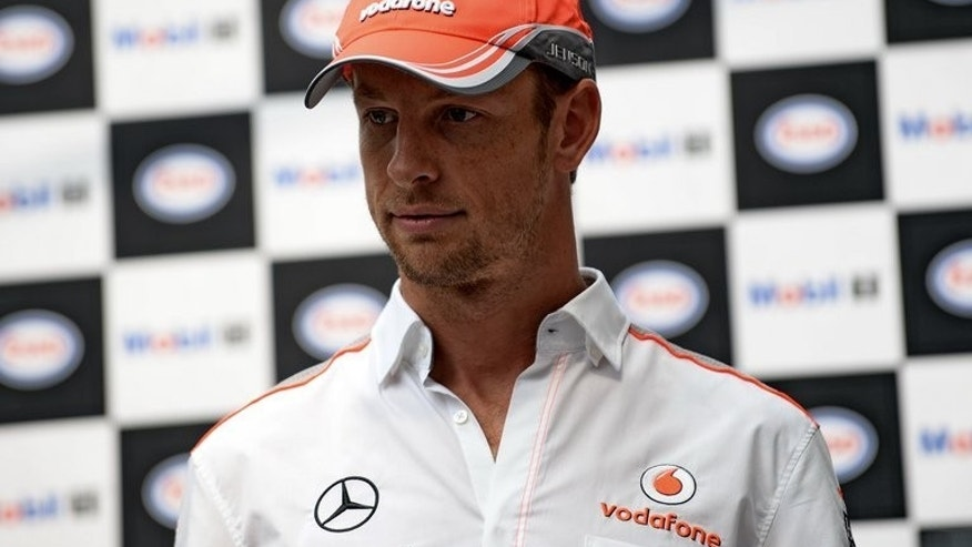 McLaren's Jenson Button, pictured during a Singapore Grand Prix promotional event on September 18, 2013, says Ferrari may have inadvertently given a boost to their rivals by re-hiring former world champion Kimi Raikkonen to join current lead driver Fernando Alonso.