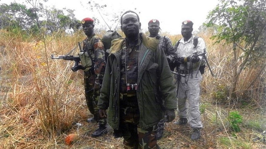 An undated handout photo released by the Central African People's Democratic Front (FDPC) shows their leader Abdoulaye Miskine standing with fighters in Biti. Police in Cameroon have arrested a rebel leader from neighbouring Central African Republic, Miskine, suspecting that he might launch cross-border raids.