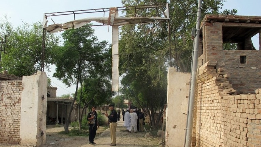 Pakistani police stand outside a prison after a Taliban attack freed Islamic militants in Dera Ismail Khan, in July. Politicians have offered talks to the Taliban, but with attacks continuing the road to peace looks as long and tortuous as ever.