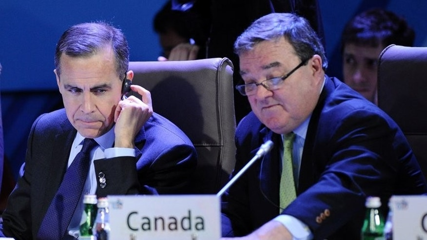 Canada's Finance Minister Jim Flaherty (R) and Mark Carney, Governor of the Bank of Canada, in Moscow, on February 16, 2013.