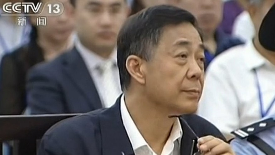 Fallen Chinese political star Bo Xilai, shown on trial August 26, 2013 in Jinan, has written a defiant letter from prison vowing to clear his name