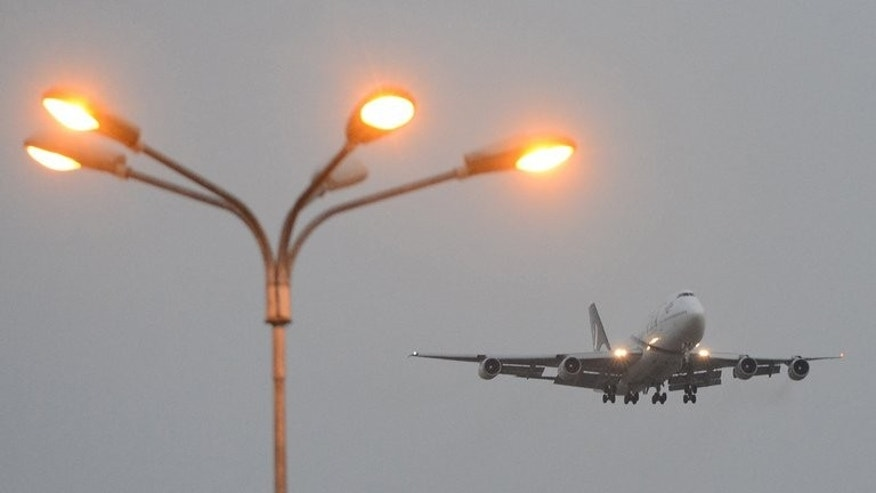 A Pakistan International Airlines (PIA) plane prepares to land in Islamabad on September 13, 2013. A pilot believed to be working for the airline has been arrested at a British airport on suspicion of being drunk in charge of a plane, police said.