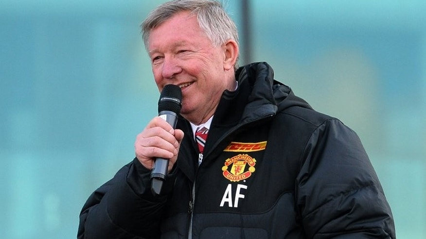 Alex Ferguson addresses crowds outside Old Trafford Stadium in Manchester, on May 13, 2013. Ferguson on Thursday hit back at claims he intentionally influenced officials after ex-referee Mark Halsey revealed his close relationship with the former Manchester United manager.
