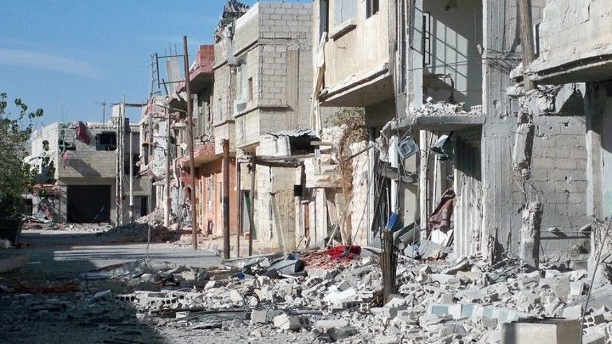 A picture taken on September 17, 2013 in the Shebaa district of Damascus shows a street that was destroyed during the Syrian conflict opposing the rebel fighters and the forces loyal to the regime.