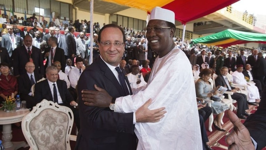 President Francois Hollande of France greets his Chadian counterpart Idriss Deby Itno during the inauguration of Mali's new president on September 19, 2013 in Bamako.